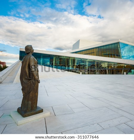 The Oslo Opera House Is The Home Of The Norwegian National Opera And Ballet. The Roof Of Building Angles To Ground Level Creating A Plaza Inviting Pedestrians To Walk Up And Enjoy Views Of Oslo. - stock photo