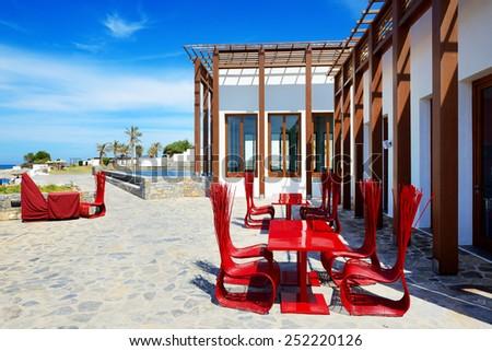 The outdoor restaurant near beach at luxury hotel, Crete, Greece - stock photo
