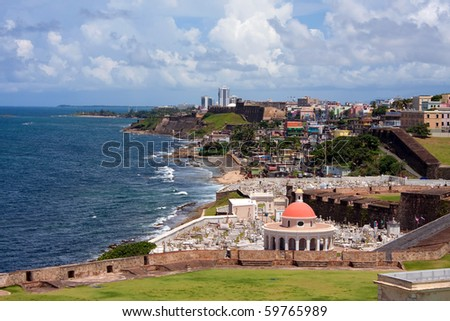 The outer walls of El Morro fort and Santa Maria Magdalena de Pazzis colonial era cemetery located in Old San Juan Puerto Rico. - stock photo