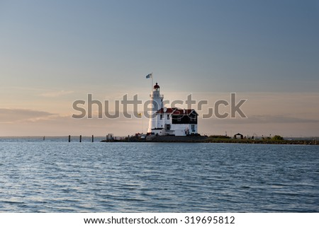 The Paard van Marken lighthouse, translated as â??Horse of Markenâ?, is a famous Dutch lighthouse located at the Ijsselmeer at the village called Marken - stock photo