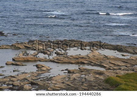 The Pacific Ocean beyond the rocky shore of the National Monument