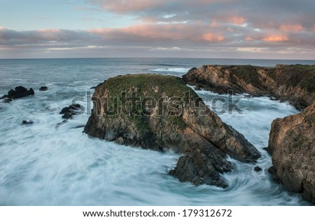 The Pacific Ocean pounds against the rocky coast of Northern California near Salt Point State Park, north of San Francisco. - stock photo