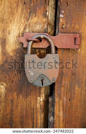 The  padlock on an old wooden door - stock photo