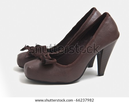 The pair of brown womans shoes isolated on white background  . - stock photo
