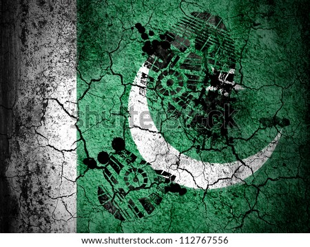 The Pakistani flag painted on  cracked ground with vignette with dirty oil footprint over it - stock photo
