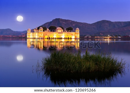 The palace Jal Mahal at night.  Jal Mahal (Water Palace) was built during the 18th century in the middle of Man Sager Lake.  Jaipur, Rajasthan, India. - stock photo