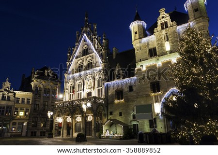 The Palace of the Great Council and the unfinished Gothic Belfry on the Grote Markt in Mechelen in Belgium