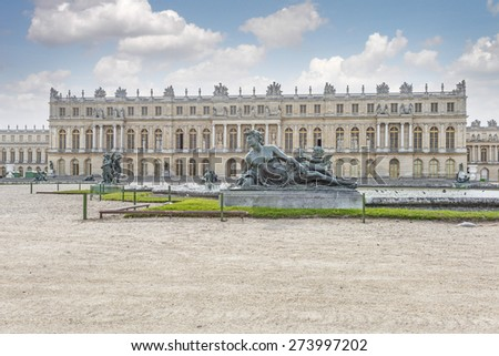 The palace of Versailles (Chateau de Versailles) from the gardens, the residence of the sun king Louis XIV. - stock photo