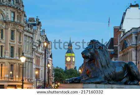 The Palace of Westminster Big Ben and Trafalgar Square at night, London, England, UK - stock photo