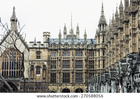 The Palace of Westminster is the meeting place of the House of Commons and the House of Lords, the two houses of the Parliament of the United Kingdom. - stock photo