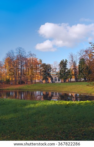 The palace on the shore of the pond in the park of Pushkin near St. Petersburg at autumn - stock photo