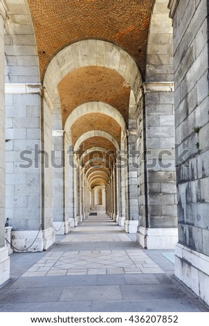 The Palacio Real de Madrid (Royal Palace) is the ceremonial residence of the royal Spanish family. The baroque monument is open to the public. lateral arches detail  - stock photo