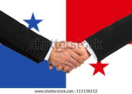 The Panama flag and business handshake - stock photo
