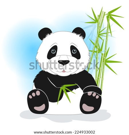 The panda sits with bamboo leaves on a white background, behind bamboo stalks - stock photo