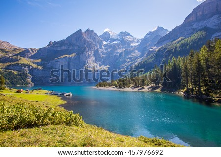 The panorama in summer view over the Oeschinensee (Oeschinen lake)