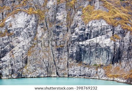 The panoramic view of a steep coastline in Glacier Bay national park (Alaska). - stock photo