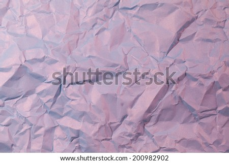 The paper is creased, crumpled blue. - stock photo