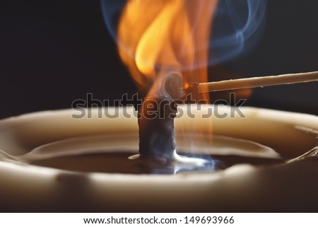 The paraffin candle and match burn