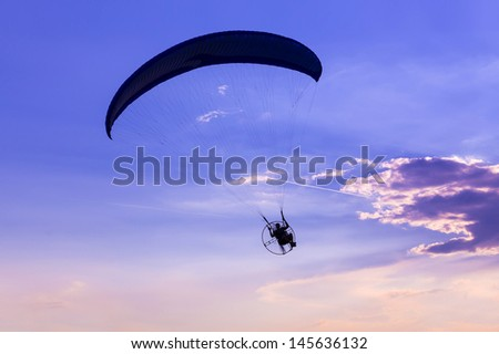 the paraglider conquer the skies - stock photo