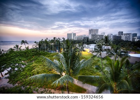 The park near Waikiki Beach with the city skyline of Oahu, Hawaii - stock photo