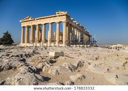 The Parthenon is a temple on the Athenian Acropolis, Greece, dedicated to the maiden goddess Athena, whom the people of Athens considered their patron deity. Its construction began in 447 BC  - stock photo
