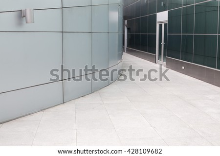 The passage of modern building selective focus at door. - stock photo