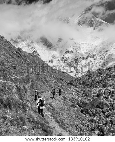 The path to the Island peak (6189 m) in district mount Everest (view from Lhotse glacier) - Nepal, Himalayas (black and white) - stock photo