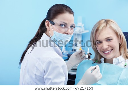 The patient and dentist in dental - stock photo