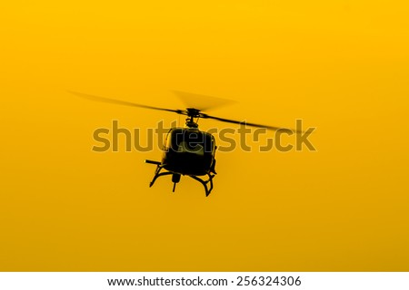 The patrol helicopter flying in the sky, soft focus motion blur