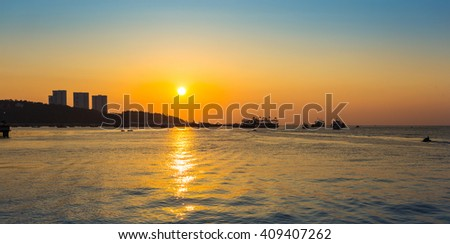 The Pattaya city harbor at twilight, Thailand - stock photo