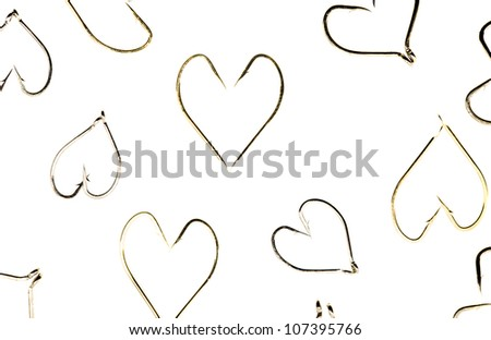 the patterns of heart made of fishing hooks - stock photo