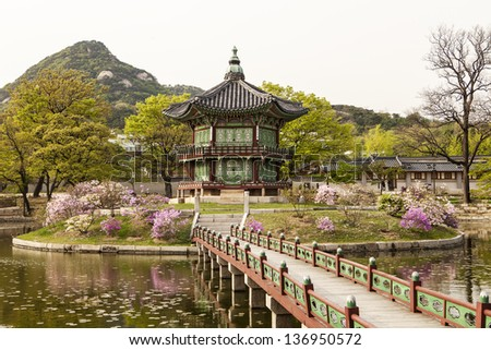 The Pavilion of Far-Reaching Fragrance is a small pagoda on an artificial island in the center of a small lake in the Gyeongbokgung Palace complex in Seoul. - stock photo