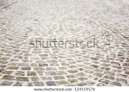 the paving stone and snow - stock photo