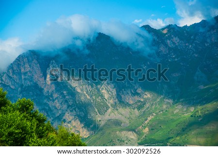 The peaks of blue-green mountains against the sky,the summer.The Caucasus..Russia.