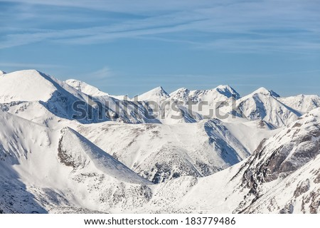 The peaks of the Tatra Mountains in the snow - stock photo