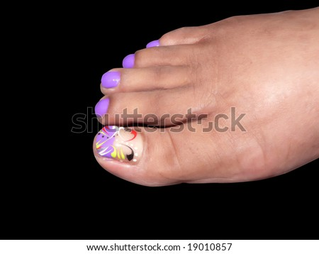 the pedicured foot of a african american woman isolated on a black background via clipping path - stock photo