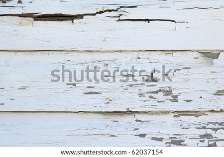 The peeling paint of an old wall on a storage structure located in an old farming community in the midwest.  Could be used as a texture or a background. - stock photo