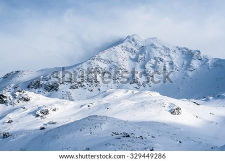 The Peleaga Peak, the highest point in Retezat Mountains, Romania - stock photo