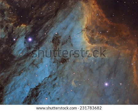 The Pelican Nebula, also known as IC5070, is an emission nebula about 1,800 light years away in the constellation Cygnus. - stock photo