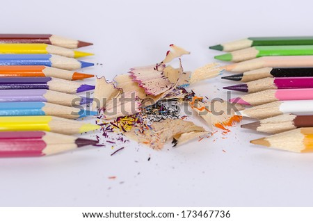 The pencil and sharpener on white background - stock photo