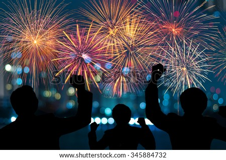 The people looks Fantastic festive new years colorful fireworks on cityscape blurred photo bokeh,project success, holiday concept, family concept - stock photo