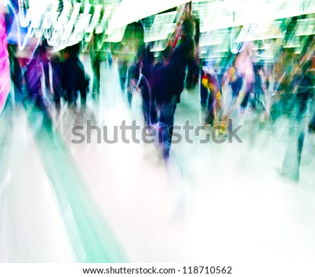 The people of the city hurriedly walking in subway station, blurred abstract background - stock photo