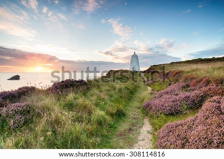 The pepperpot lighthouse on cliffs above Portreath harbour in Cornwall - stock photo