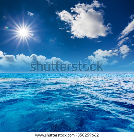 The perfect cloudy sky and surface water of ocean - stock photo