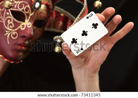 The person in a mask with cards.