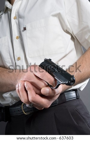 The person prepared to shoot from a pistol