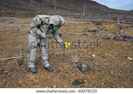 The person puts a biohazard sign - stock photo