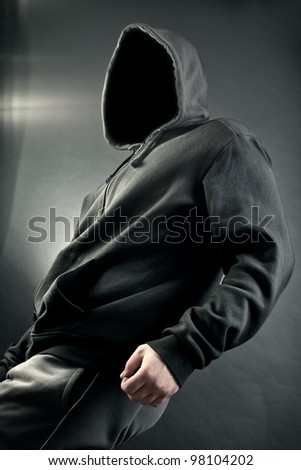 The person with the latent person. A black background - stock photo