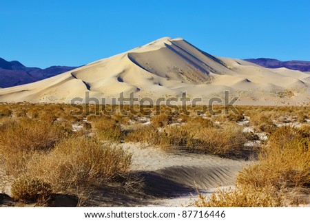 The Phenomenon of Death Valley, California - a huge sand dune Eureka on sunrise. Delightful alternation of light and shade