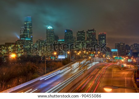 The Philadelphia, Pennsylvania skyline at night with the Schuylkill Expressway in the foreground.